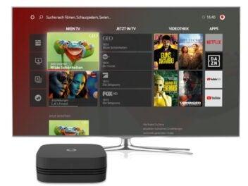 Ein Fernseher mit einer kleinen Box im Vordergrund: Die Giga TV Cable Box 2