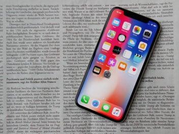 iPhone X auf einer Zeitung