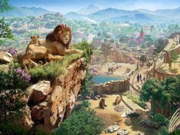 Zwei Löwen liegen auf einer Anhöhe.
