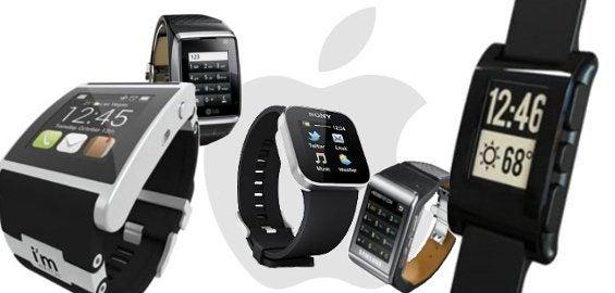 Verschiedene Smartwatches vor einem Apple-Logo