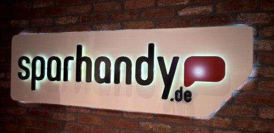 Logo von Sparhandy.de im Sparhandy-Shop in Köln.